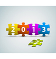 New Year 2013 card made from colorful puzzle vector image