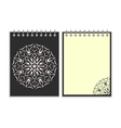 Black cover notebook with round florwer pattern vector image