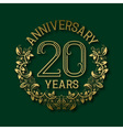 Golden emblem of twentieth years anniversary vector image