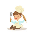 cute little boy chef with whisk and rolling pin vector image