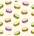 seamless beige background with colored macaroons vector image