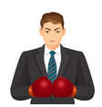 businessman in suit and boxing gloves isolated on vector image