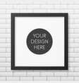 Realistic square black frame on the brick wall vector image