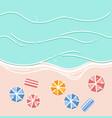 Sandy beach umbrellas and sea waves vector image