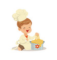 cute smiling little boy chef kneading a dough vector image