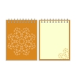 Orange cover notebook with round ornate star vector image