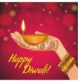 Card for diwali with diya decoration in woman hand vector