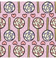 Seamless pattern with lollipops and hearts on vector image