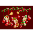 Hanging christmas socks with present and balls vector image vector image
