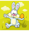 easter bunny sitting on green grass holding egg vector image