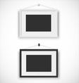 Blank picture frame set hanging on wall vector image