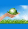 human hand holding green globe vector image