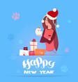 woman in santa hat holding cute pomerian dog vector image