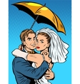 Couple in love bride and groom under an umbrella vector image