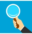 Magnifying icon in a hand vector image