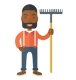 Man with a mustache holding a rake vector image