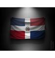 waving flag Dominican Republic on a dark wall vector image vector image
