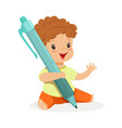 cute little boy sitting on the floor and holding a vector image vector image