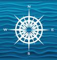 wind rose over blue waves background vector image vector image