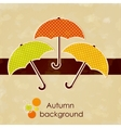 Autumn background with colored umbrellas vector image