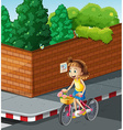Little girl riding bike on the road vector image