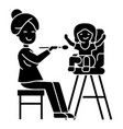 mother feeding child icon vector image