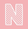 N alphabet letter with white polka dots on pink vector image
