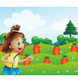 A happy girl watering the carrots in the farm vector image vector image