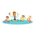 teacher and kids sitting on the floor learning vector image