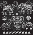 Set of decorated elephants on black vector image