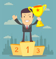 businessman holding winner s cup vector image