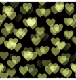 Golden heart shapes isolated on black background vector image