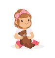 adorable little girl playing with teddy bear vector image