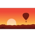 Silhouette of air balloon at sunset vector image