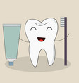 tooth with a toothbrush smiling vector image