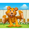 A bear playing near the wooden fence vector image