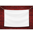 white banner hanging on a brick wall background vector image
