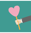 Businessman hand holding heart on stick vector image