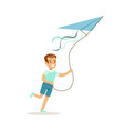 smiling boy playing with kite kids outdoor vector image