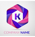 K Letter colorful logo in the hexagonal on grey vector image