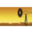 Silhouette of windmill at sunrise vector image