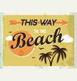 Grunge retro metal sign this way to the beach vector image