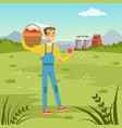 farmers man holding basket with fresh harvest of vector image