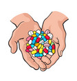 two cupped hands holding handful pile of colorful vector image