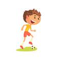 young soccer player kicking the ball cartoon vector image