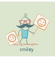 people holding posters with funny and sad smiles vector image