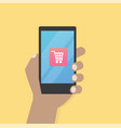 hand with cart icon on mobile phone vector image vector image