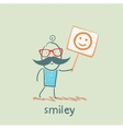 man holds a poster with a smiley vector image vector image