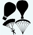 Hot air balloon in the sky and man jumping with pa vector image vector image