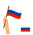 human hand holding flag of russia vector image
